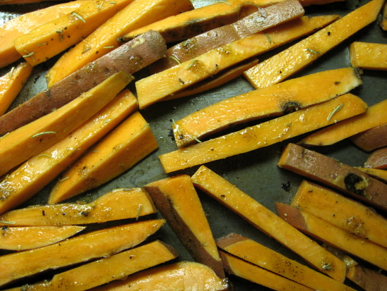 Put them in single layer on a large baking sheet. Set a kitchen time for 20 minutes. When it goes off, turn your fries over, then set the timer for another 20-25 minutes, depending on how crispy you want them.