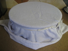 Drape a towel over it (cheesecloth or cloth diapers work, too), and attache around the edges of the bowl with an elastic rubber band.